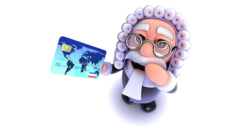 Smiling judge holding a credit card